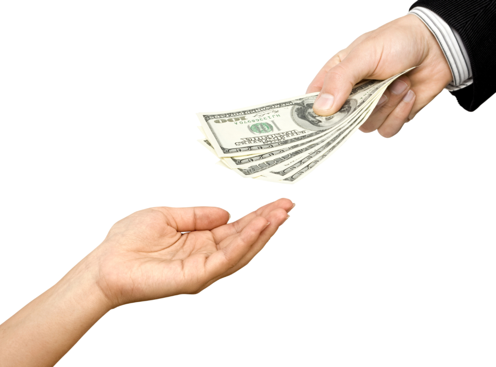 One man's hand gives dollars to other hand